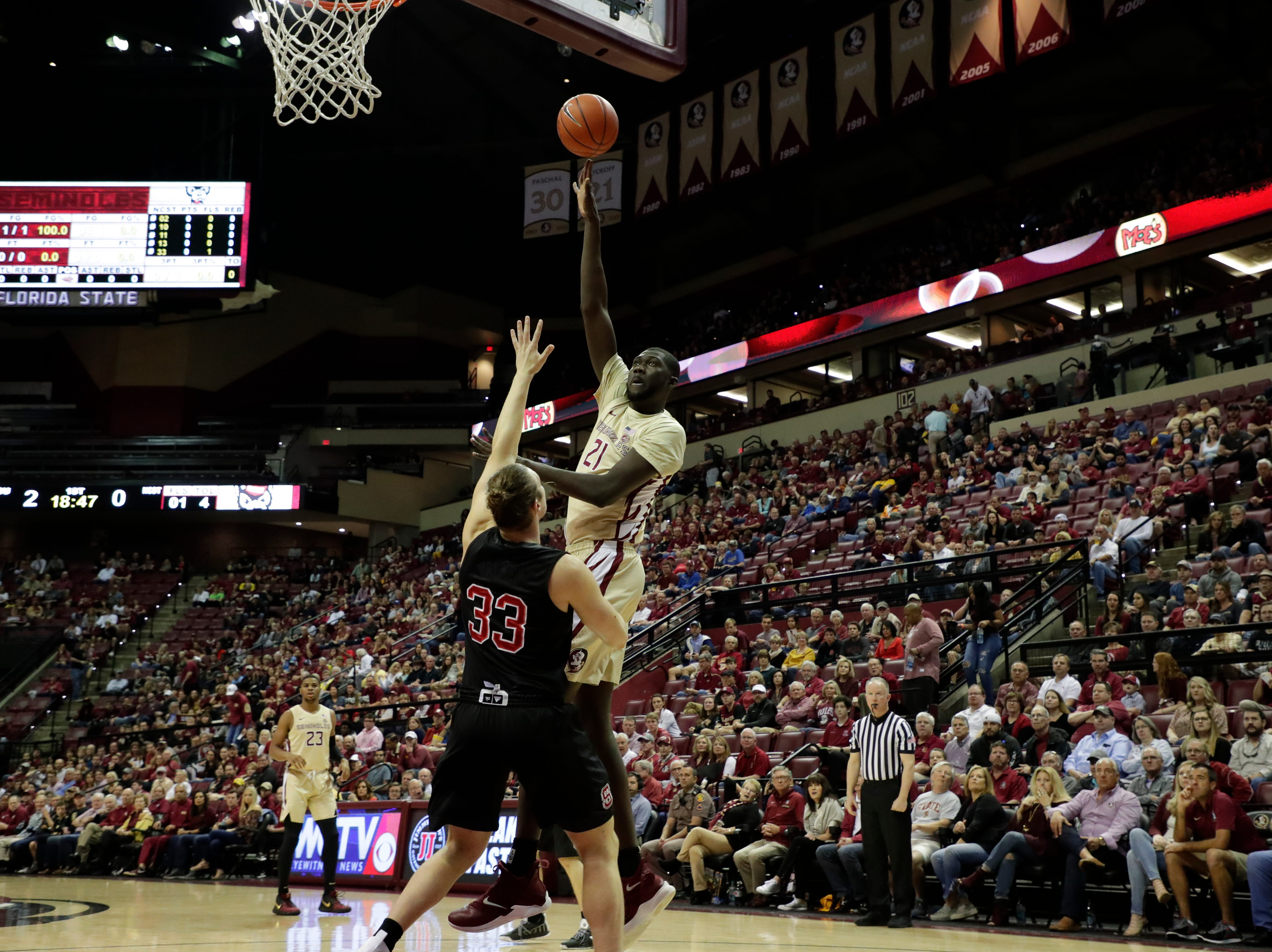 Florida State Seminoles center Christ Koumadje (21) shoots for two. The Florida State Seminoles host the NC State Wolfpack at the Tucker Civic Center Saturday, March 2, 2019.