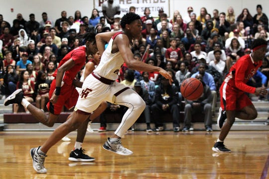 Florida High's Jaylen Martin races up the court as the Seminoles fell 61-46 to Andrew Jackson during a Region 1-5A final on March 1, 2019.