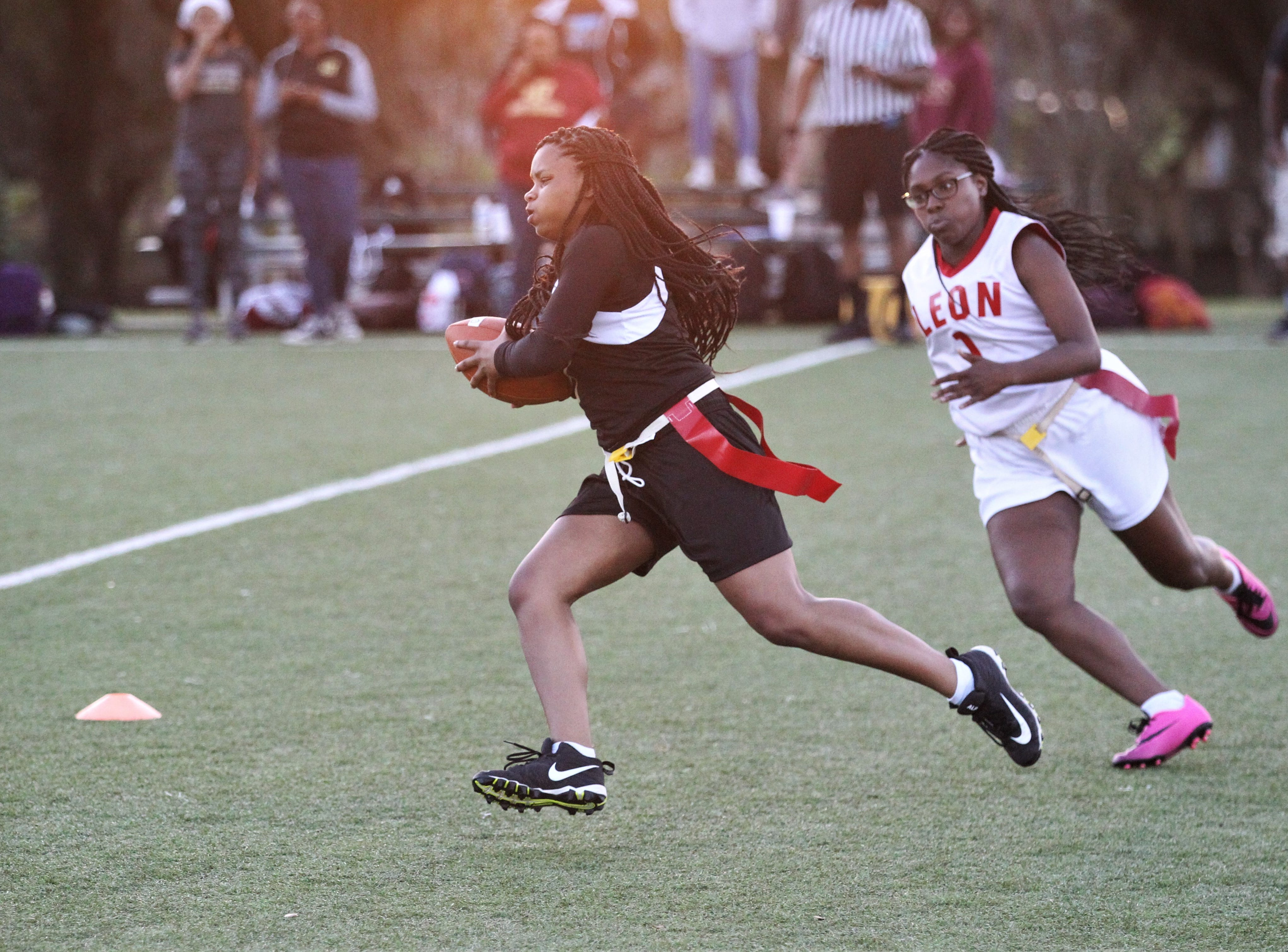Florida High's Tamauria Youngblood runs for a gain as the Seminoles and Leon play during the 2019 flag football preseason classic at Florida A&M's intramural turf fields on Feb. 27, 2019.