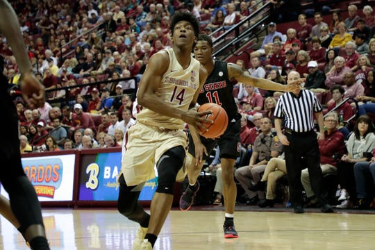 Florida State Seminoles guard Terance Mann (14) drives the ball in for a layup. The Florida State Seminoles host the NC State Wolfpack at the Tucker Civic Center Saturday, March 2, 2019.