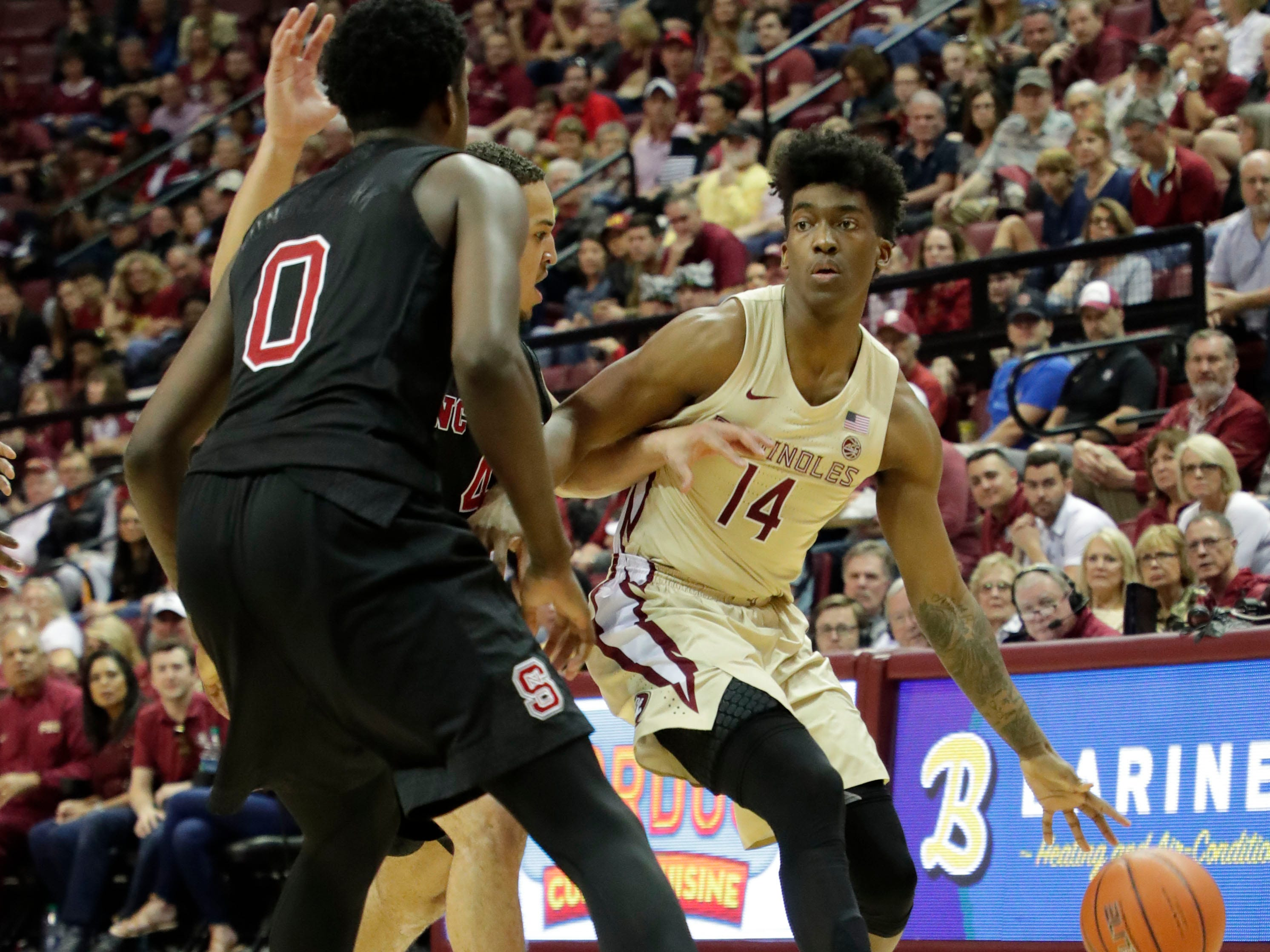 Florida State Seminoles guard Terance Mann (14) drives the ball to the hoop. The Florida State Seminoles host the NC State Wolfpack at the Tucker Civic Center Saturday, March 2, 2019.