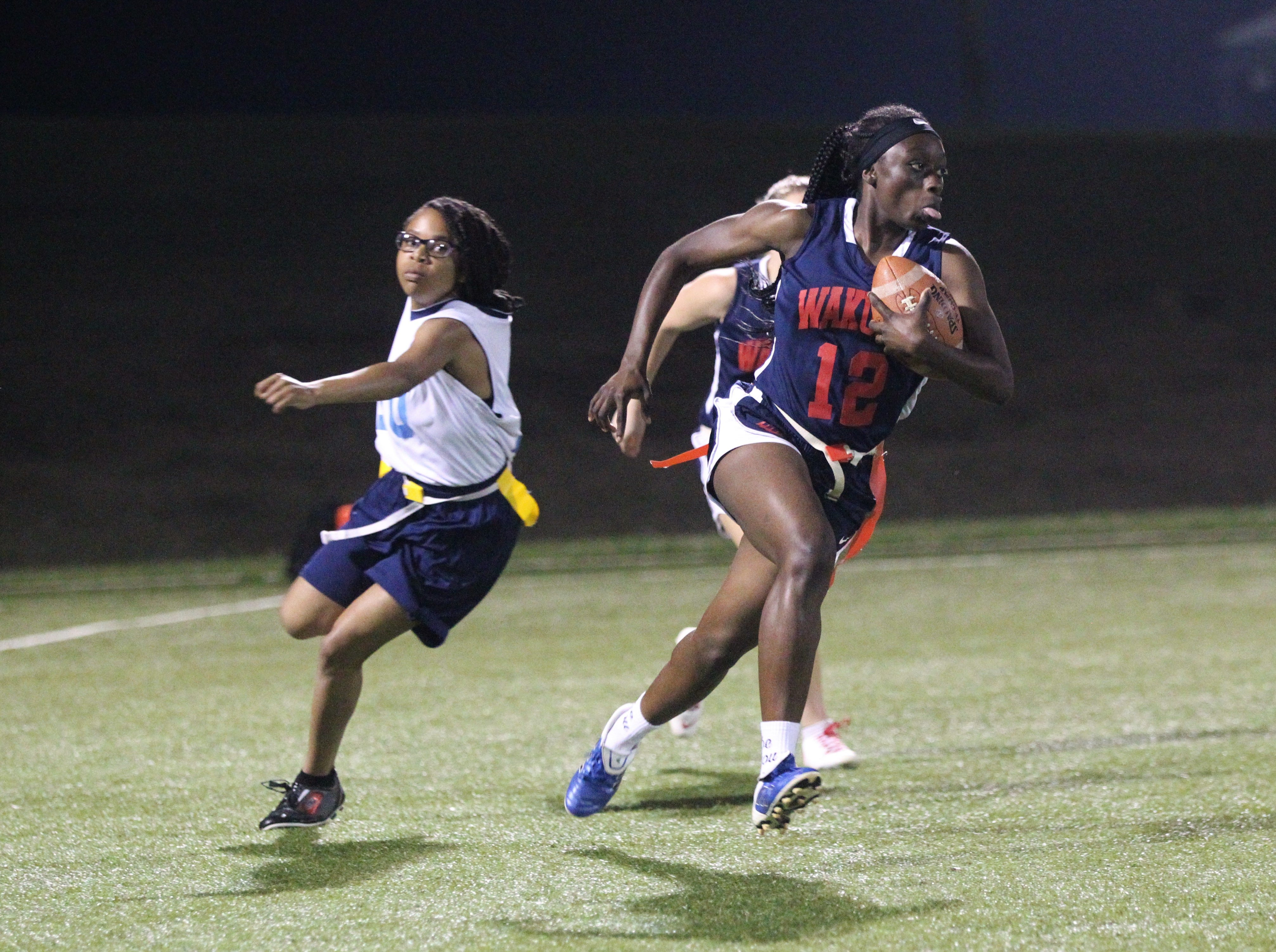 Wakulla running back Ja'daa Wilson turns the corner on a big gain as the War Eagles and Gadsden County play during the 2019 flag football preseason classic at Florida A&M's intramural turf fields on Feb. 27, 2019.