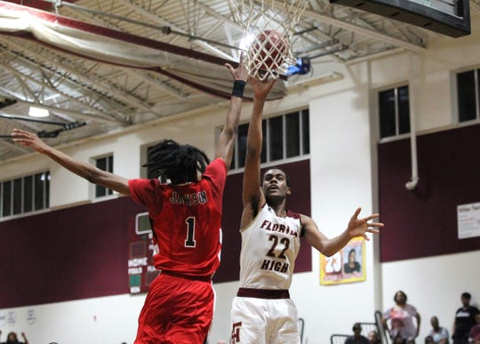 Florida High's Makai Willis goes up for a post jumper as the Seminoles fell 61-46 to Andrew Jackson during a Region 1-5A final on March 1, 2019.