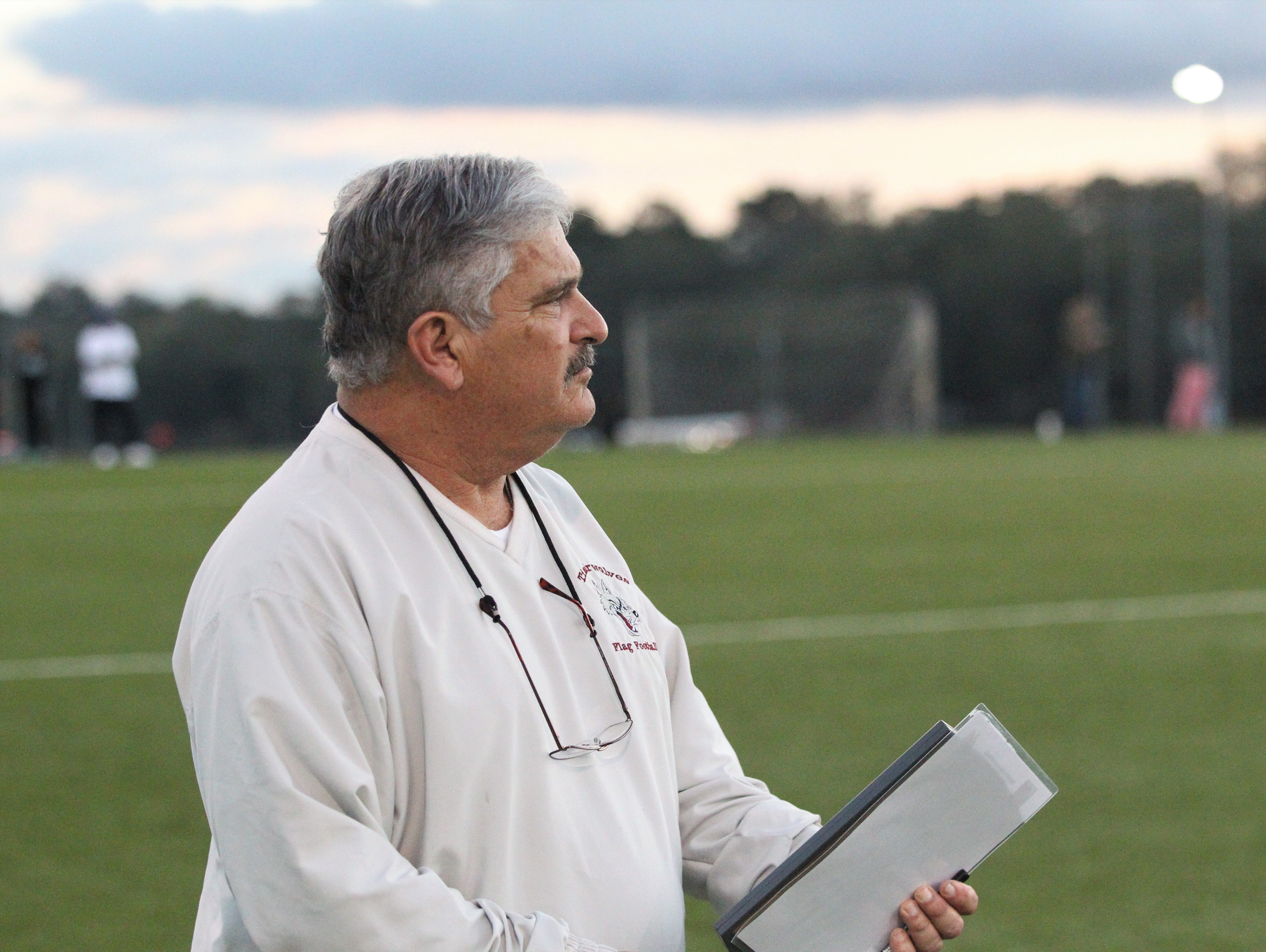 Chiles flag football coach Stan Goldstein watches play during the 2019 flag football preseason classic at Florida A&M's intramural turf fields on Feb. 27, 2019.