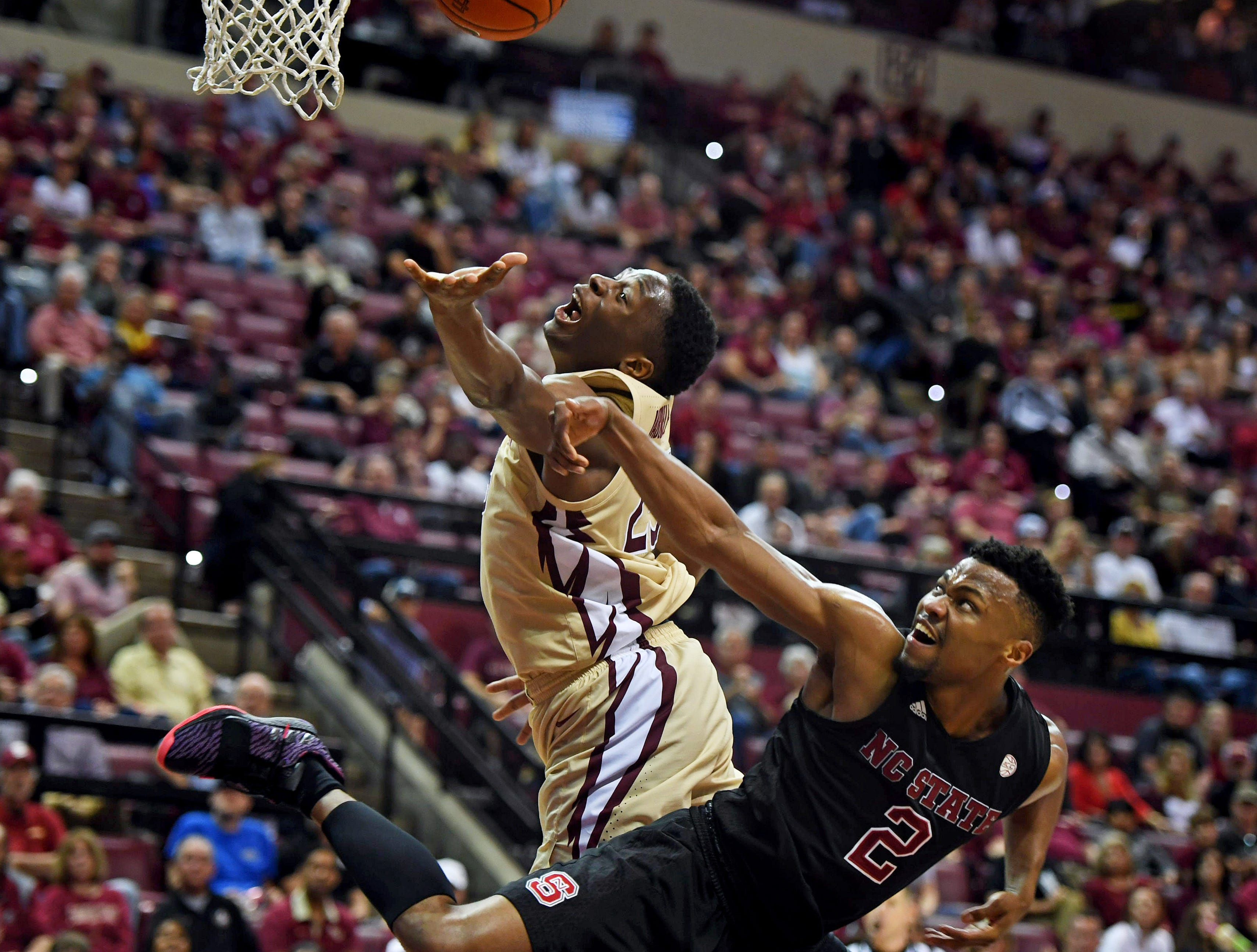 Mar 2, 2019; Tallahassee, FL, USA; Florida State Seminoles forward Mfiondu Kabengele (25) fights for a rebound against North Carolina State Wolfpack guard Torin Dorn (2) during the second half at Donald L. Tucker Center. Mandatory Credit: Melina Myers-USA TODAY Sports