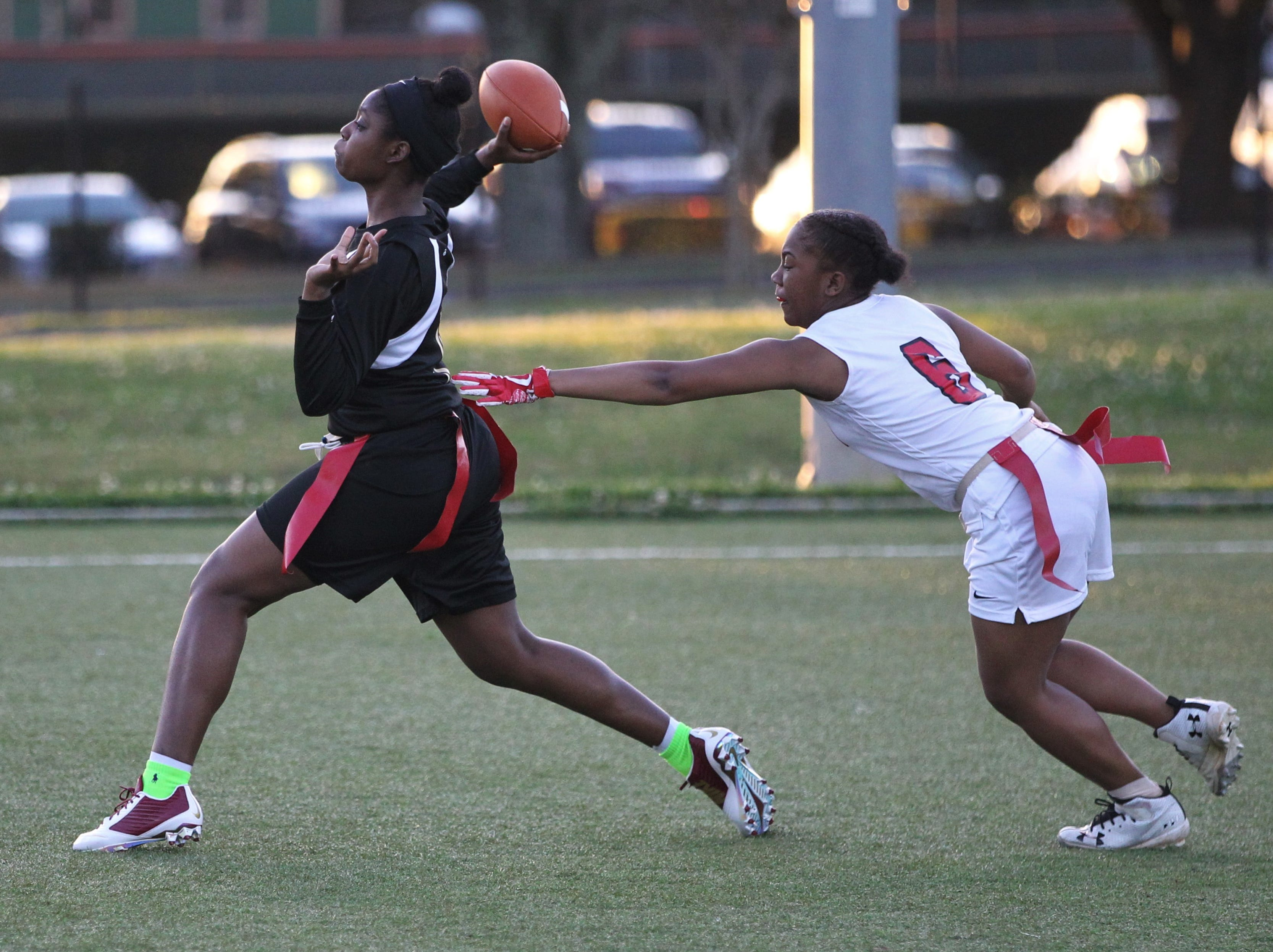Florida High quarterback Kyndall Thomas throws a pass as the Seminoles and Leon play during the 2019 flag football preseason classic at Florida A&M's intramural turf fields on Feb. 27, 2019.