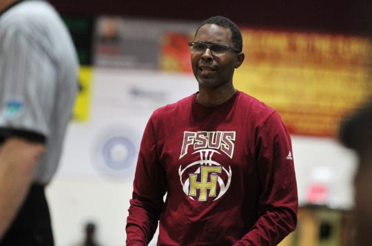 Florida High boys basketball coach Charlie Ward watches as the Seminoles fell 61-46 to Andrew Jackson during a Region 1-5A final on March 1, 2019.
