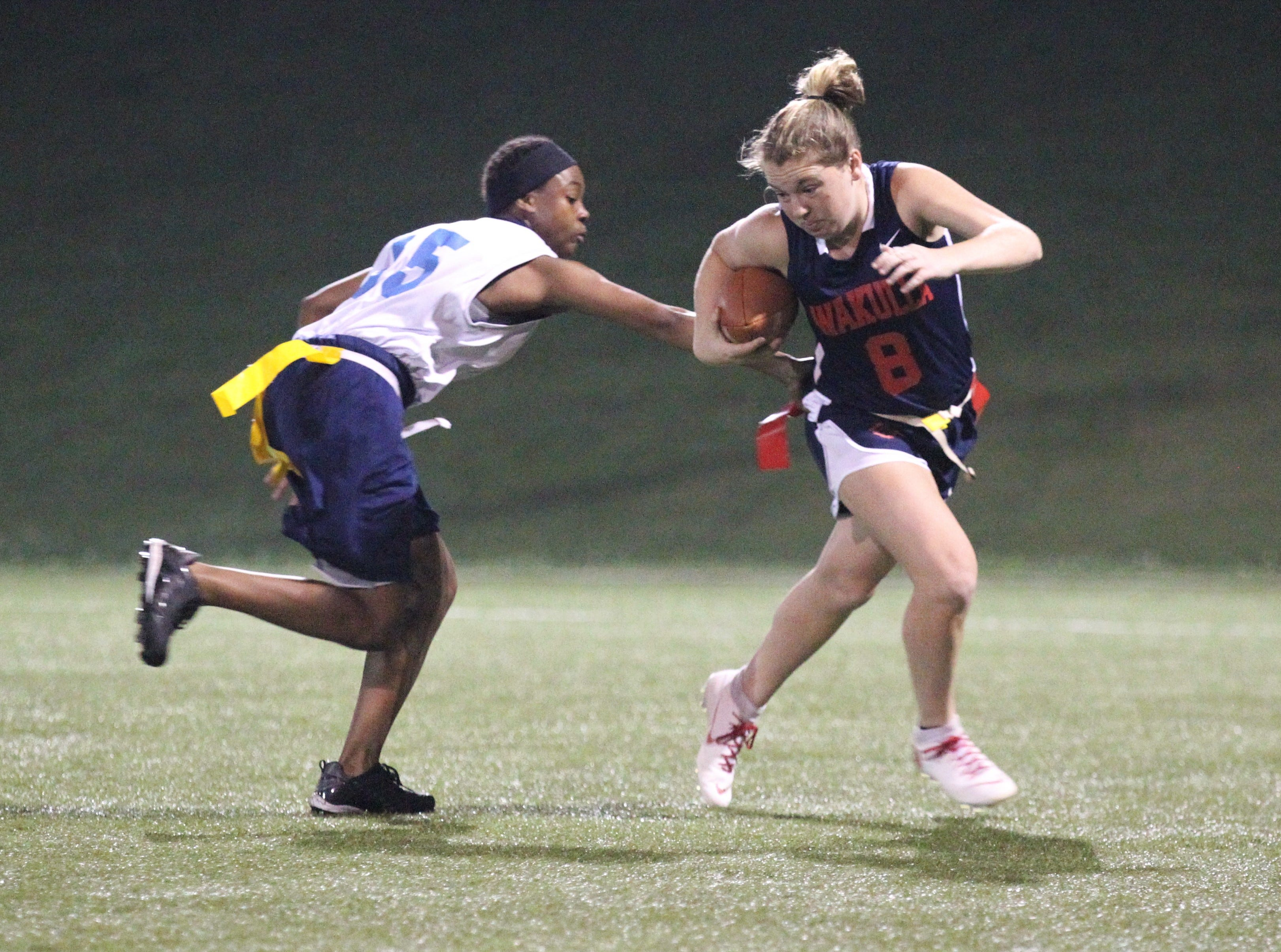 Wakulla quarterback Caitlyn Cason tries to escape a sack as the War Eagles and Gadsden County play during the 2019 flag football preseason classic at Florida A&M's intramural turf fields on Feb. 27, 2019.