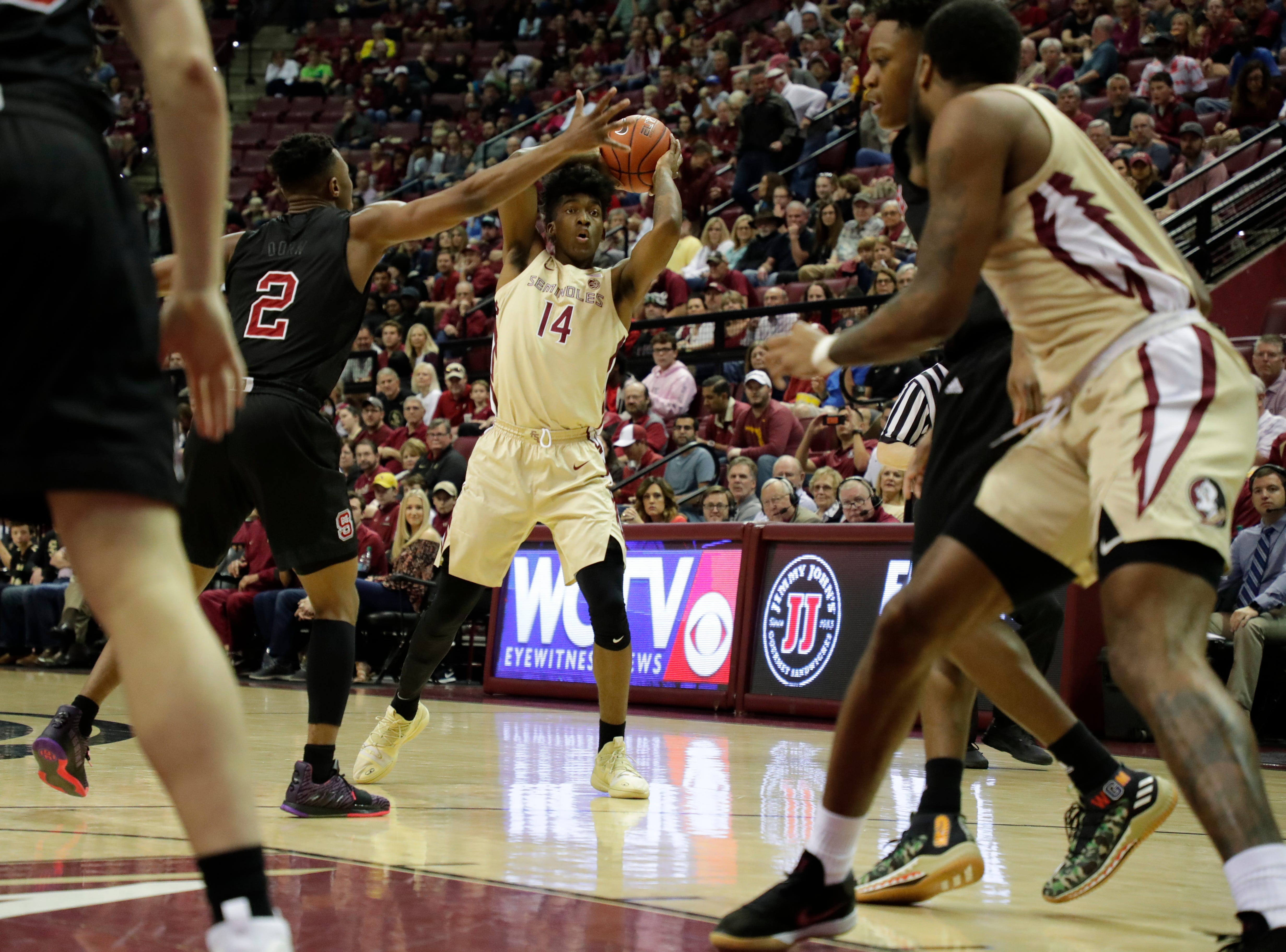 Florida State Seminoles guard Terance Mann (14) looks to pass. The Florida State Seminoles host the NC State Wolfpack at the Tucker Civic Center Saturday, March 2, 2019.