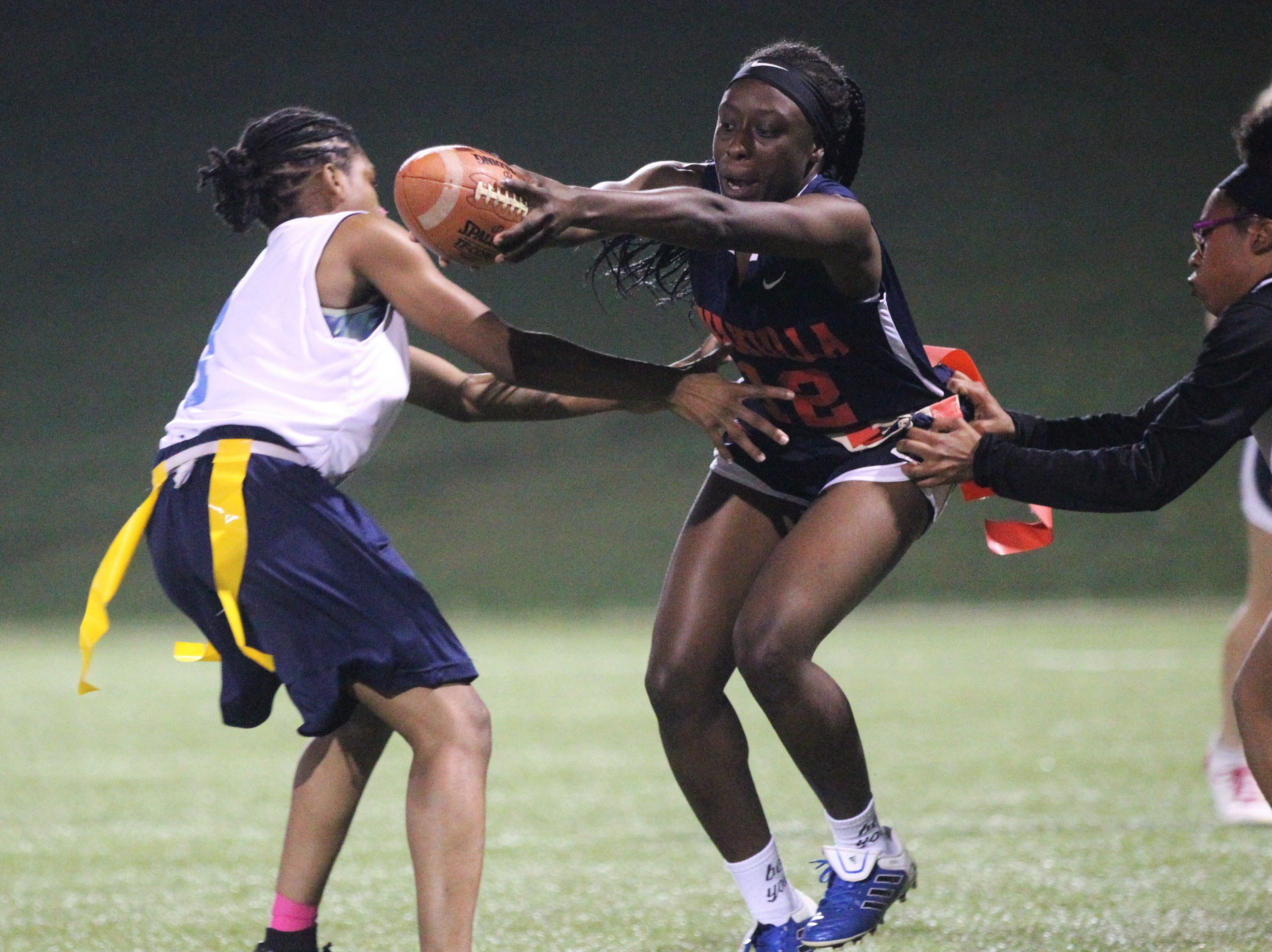 Wakulla running back Ja'daa Wilson has her flags pulled as the War Eagles and Gadsden County play during the 2019 flag football preseason classic at Florida A&M's intramural turf fields on Feb. 27, 2019.