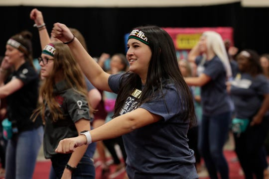 Starr Mandell follows along with others doing the line dance at Florida State University's 2019 Dance Marathon Friday, March 1, 2019.