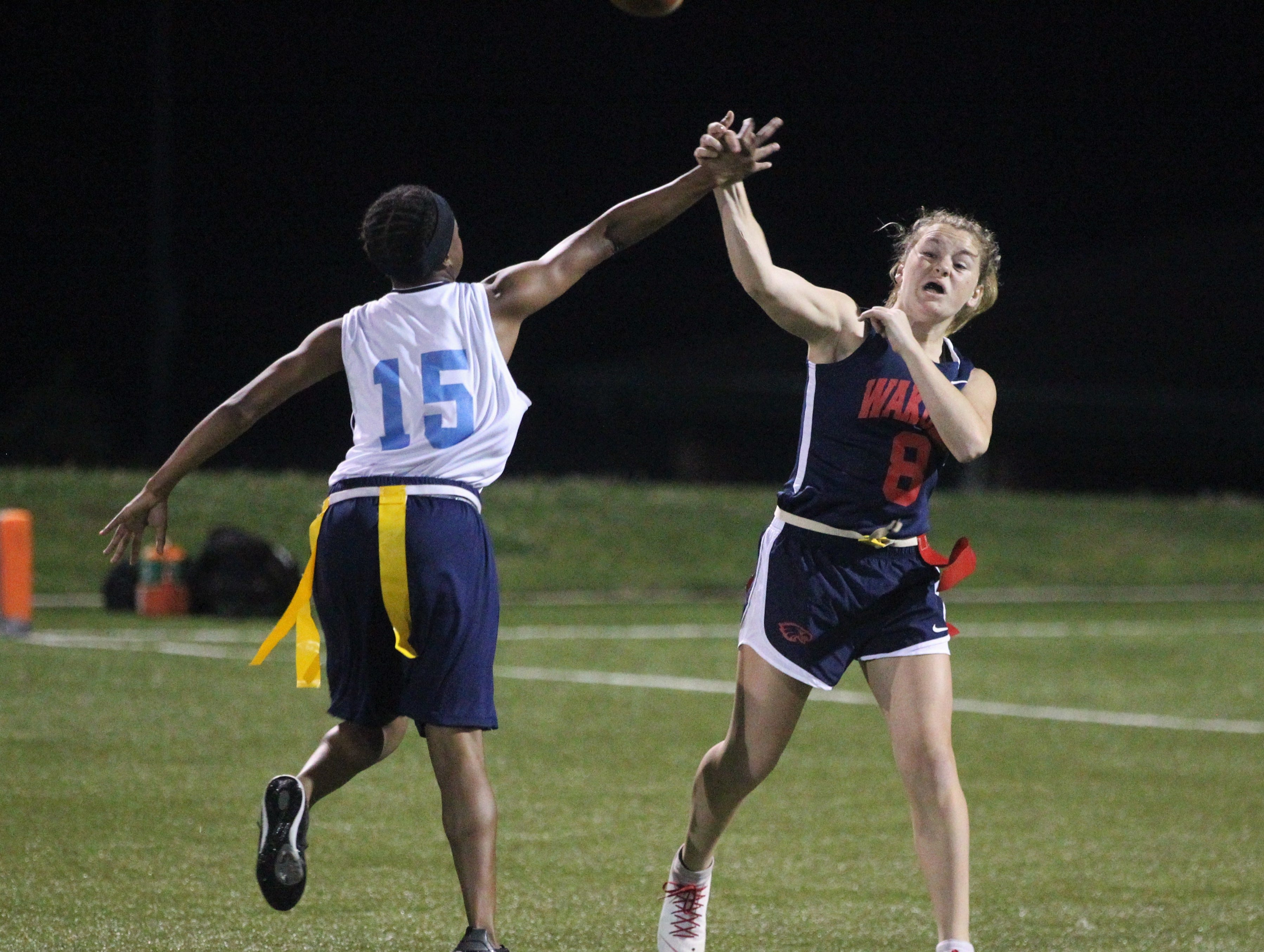 Wakulla quarterback Caitlyn Cason is hit as she throws a pass as the War Eagles and Gadsden County play during the 2019 flag football preseason classic at Florida A&M's intramural turf fields on Feb. 27, 2019.