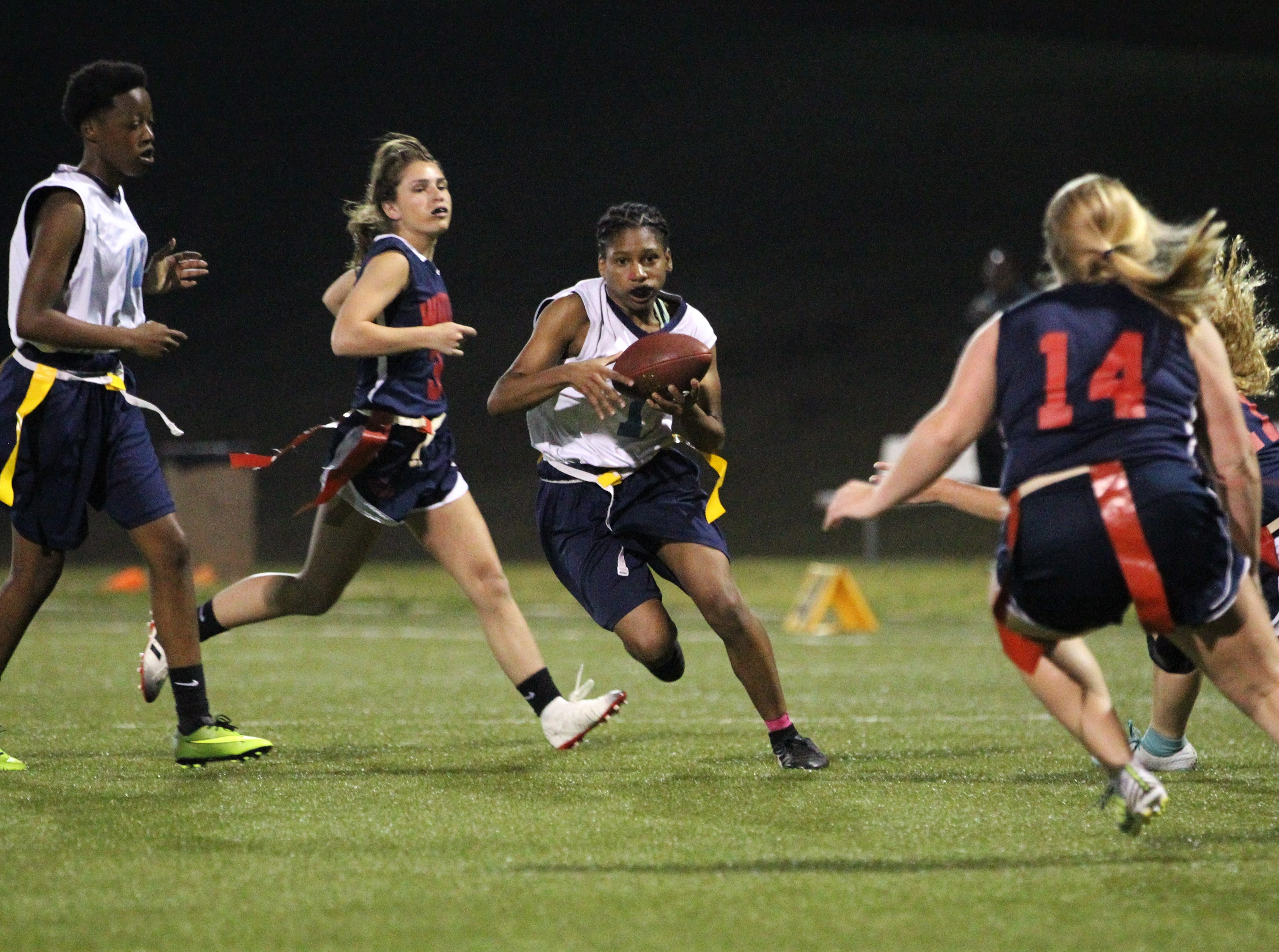 Gadsden County running back Justice Butler runs for a gain as the Jaguars and Wakulla play during the 2019 flag football preseason classic at Florida A&M's intramural turf fields on Feb. 27, 2019.