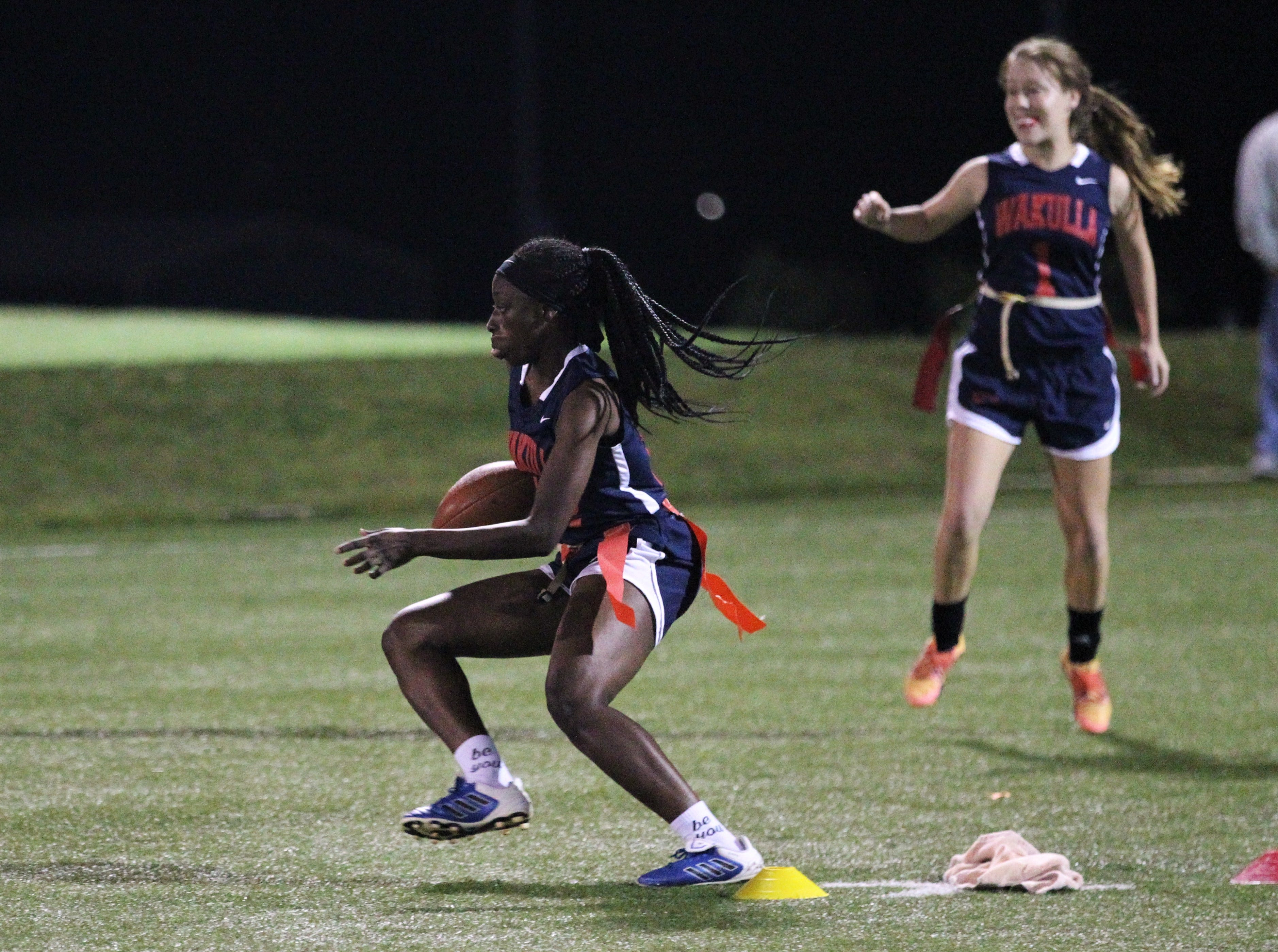 Wakulla running back Ja'daa Wilson runs for a gain as the War Eagles and Gadsden County play during the 2019 flag football preseason classic at Florida A&M's intramural turf fields on Feb. 27, 2019.