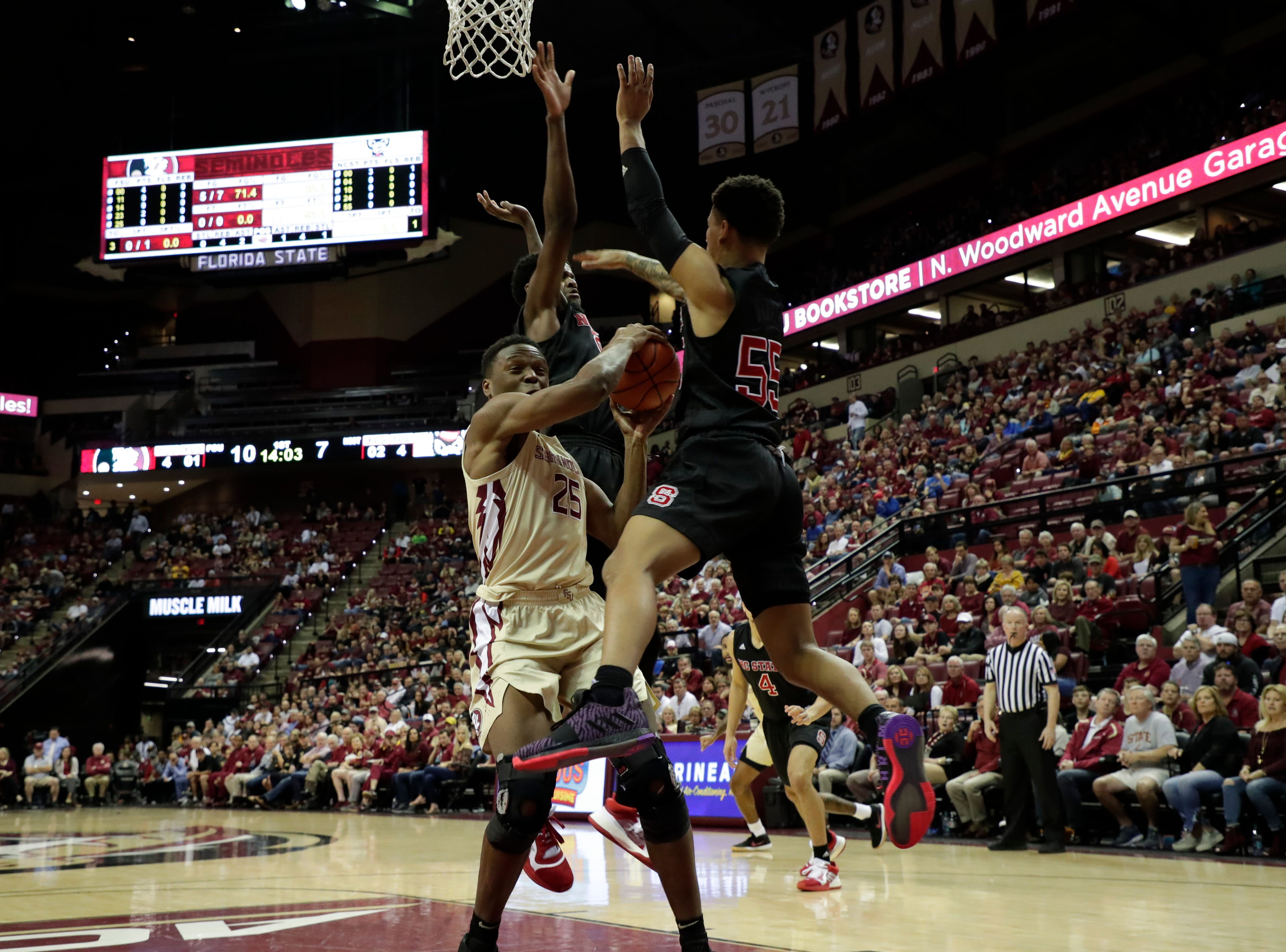 Florida State Seminoles forward Mfiondu Kabengele (25) fights his way to put up a shot. The Florida State Seminoles host the NC State Wolfpack at the Tucker Civic Center Saturday, March 2, 2019.
