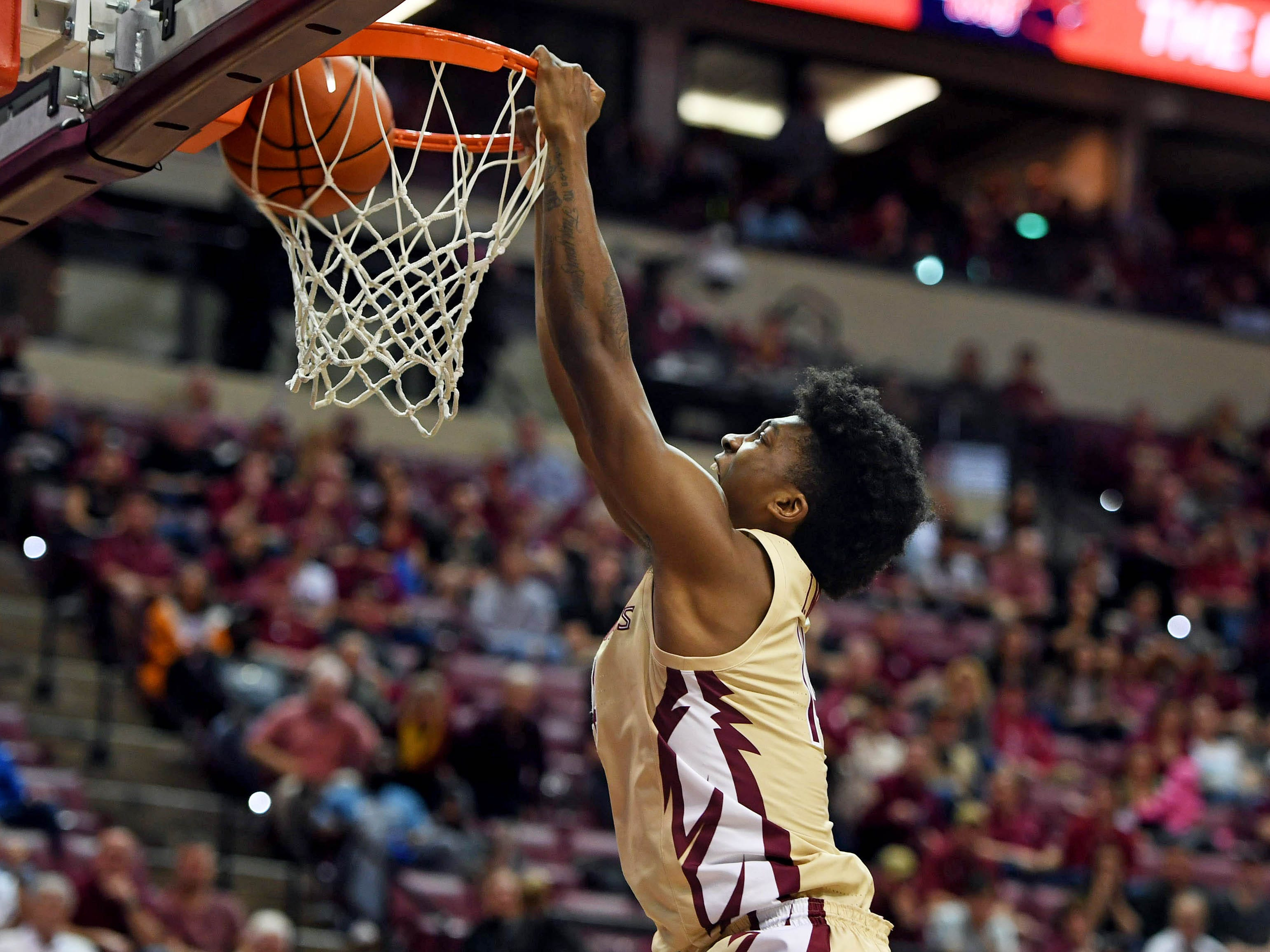 Mar 2, 2019; Tallahassee, FL, USA; Florida State Seminoles guard Terance Mann (14) dunks the ball during the second half of the game against the North Carolina State Wolfpack at Donald L. Tucker Center. Mandatory Credit: Melina Myers-USA TODAY Sports