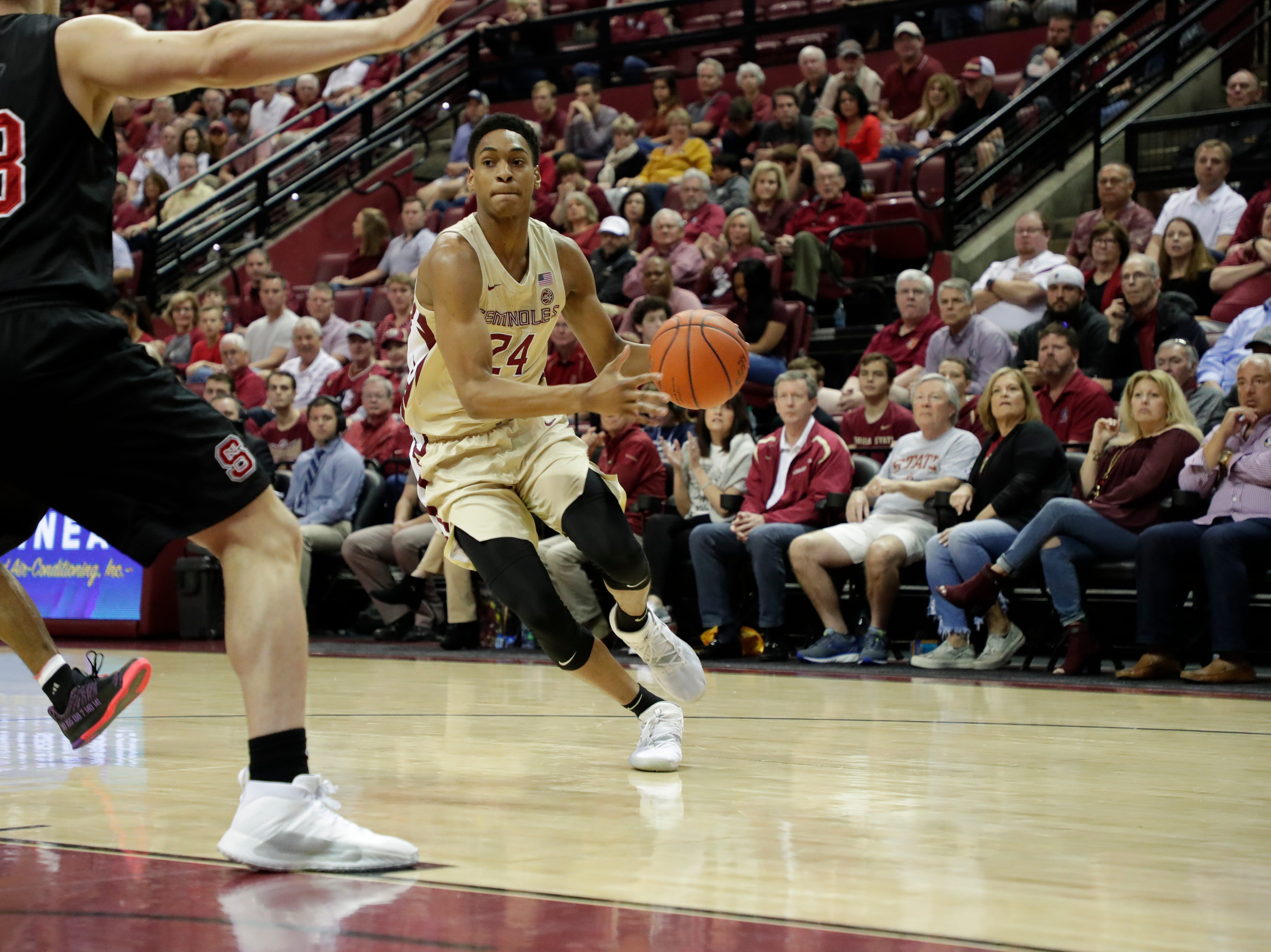 Florida State Seminoles guard Devin Vassell (24) drives the ball to the hoop. The Florida State Seminoles host the NC State Wolfpack at the Tucker Civic Center Saturday, March 2, 2019.