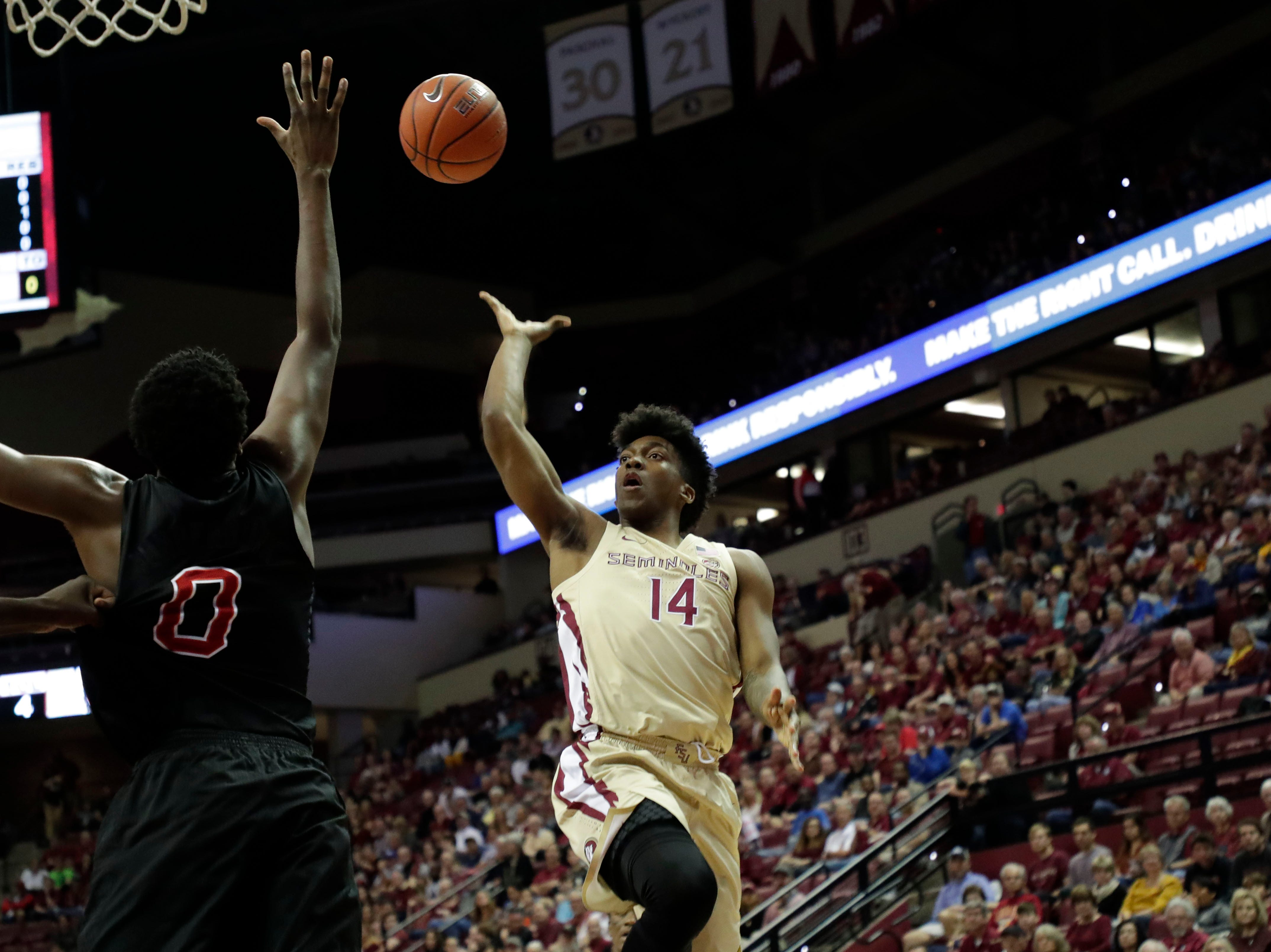 Florida State Seminoles guard Terance Mann (14) goes in for a layup. The Florida State Seminoles host the NC State Wolfpack at the Tucker Civic Center Saturday, March 2, 2019.