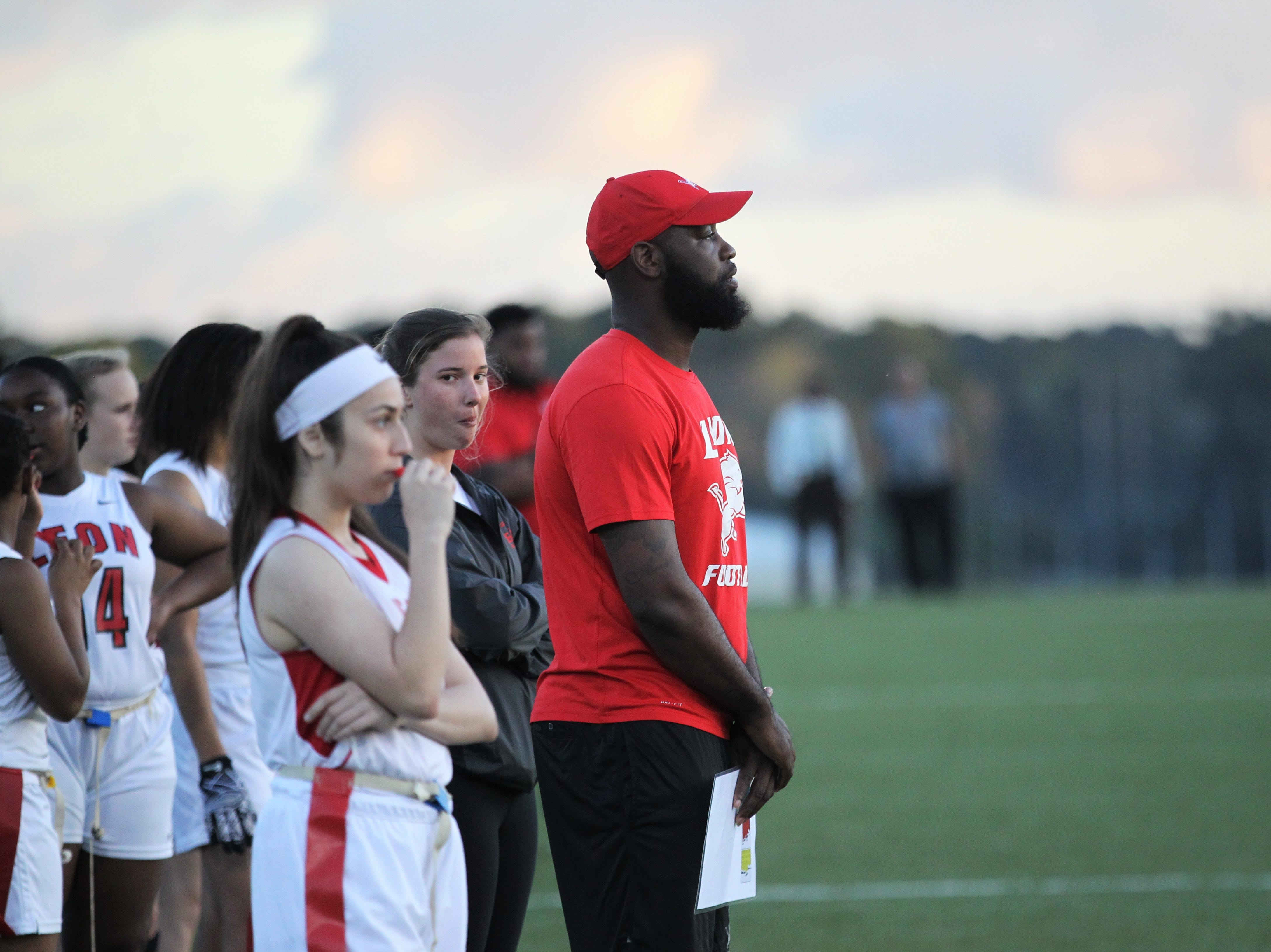 Leon flag football coach James Green watches as the Lions and Florida High play during the 2019 flag football preseason classic at Florida A&M's intramural turf fields on Feb. 27, 2019.