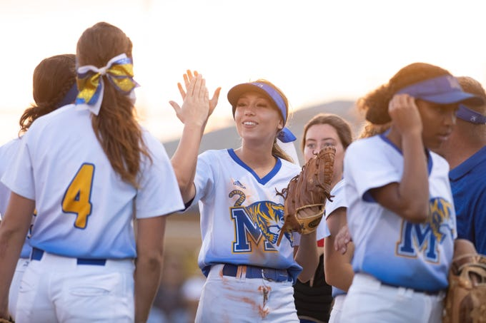 Martin County's Kaydan King (center), who plays at first base, celebrates with teammates after making an out in the second inning of their high school softball game against Jupiter at Martin County High School on Friday, March 1, 2019, in Stuart.