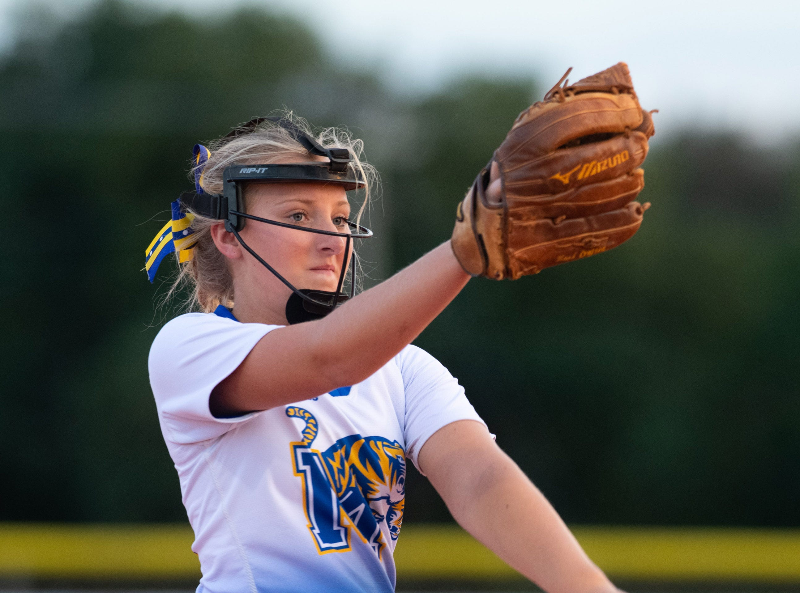 Martin County's pitcher Emily MacMullen throws a pitch in the first inning of their game against Jupiter during the high school softball game at Martin County High School on Friday, March 1, 2019, in Stuart.