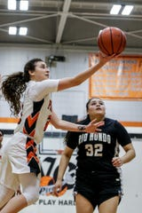 Ventura College freshman Cece Quintino lays the ball in on Friday night against Rio Hondo in the CCCAA SoCal regional semifinals at the VC Athletic Event Center. VC won, 60-49.