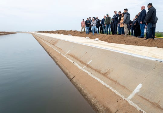 Senator Melissa Hurtado (D-Sanger) and other state and local officials pause along a key section of the Friant-Kern Canal on Friday, March 1, 2019.
