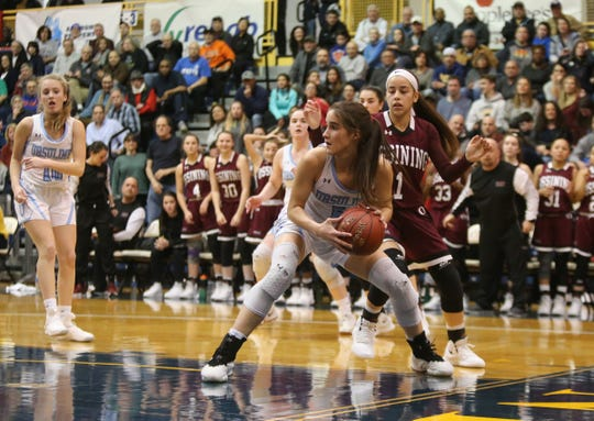 Ursuline's Sonia Citron (5) pulls in a rebound during the girls basketball Class AA section final against Ossining at Pace University in Pleasantville on Saturday, March 2, 2019.