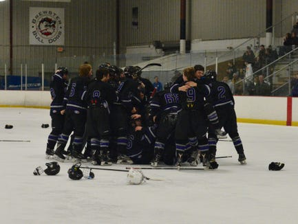 John Jay players celebrate after the team's 3-0 win over West Seneca West in the regional championship game at Brewster Ice Arena Saturday.