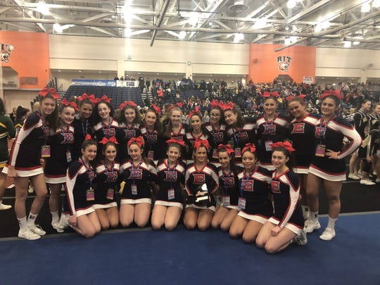 Eastchester's cheerleading team poses after taking fourth place at the state cheerleading championships in the Rochester Institute of Technology Saturday.