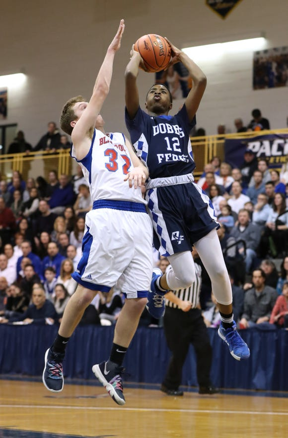 Dobbs Ferry's Lester McCarthy shoots under pressure from Blind Brook's Ryan Aiello during the Class B championship game at Pace University March 1, 2019. Dobbs Ferry won 50-45 in OT.