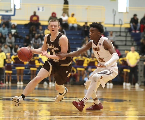 Clarkstown South's Tony Hastings (2) works against Mount Vernon's Irvin Patrick (1) during the boys basketball Class AA section final at Pace University in Pleasantville on Saturday, March 2, 2019.