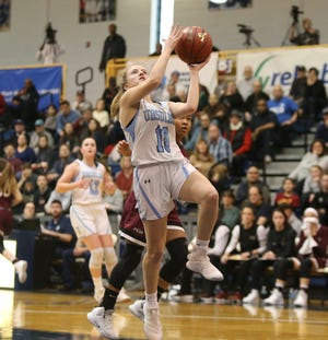 Ursuline's Alexa Mustafaj (10) puts up a shot after a breakaway during the girls basketball Class AA section final against Ossining at Pace University in Pleasantville on Saturday, March 2, 2019.