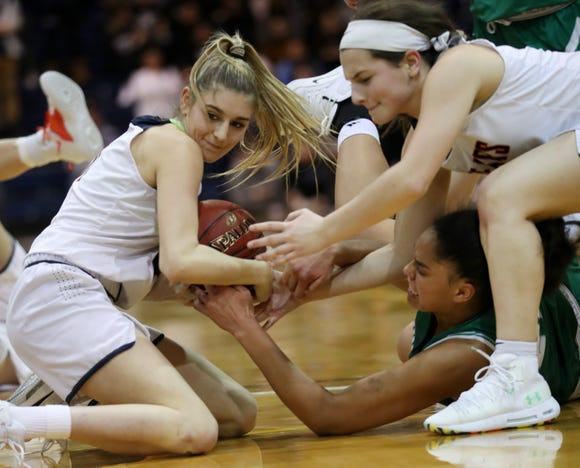 From left, Briarcliff's Julia Dallesandro and Julia Barbalato battle for a loose ball with Irvington's Grace Thybulle during the girls Section 1 Class B championship game at Pace University in Pleasantville March 1, 2019. Irvington won the game 52-49.