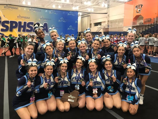 Putnam Valley's cheerleading team poses after coming in 2nd place in the small school-large team division at the state cheerleading championships at the Rochester Institute of Technology on Saturday.