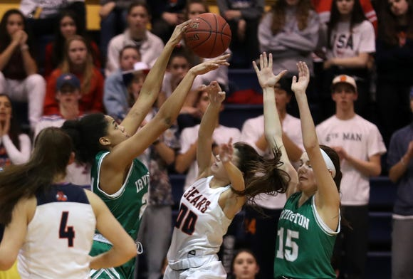 From left, Irvington's Grace Thybulle blocks a shot from Briarcliff's Kacey Hamlin during the girls Section 1 Class B championship game at Pace University in Pleasantville March 1, 2019. Irvington won the game 52-49.