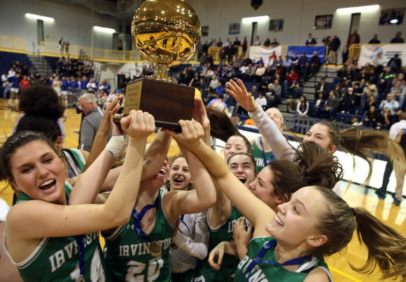 Irvington players celebrate with the gold ball after defeating Briarcliff 52-49 to win the Section 1 Class B championship game at Pace University in Pleasantville March 1, 2019.