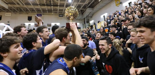 Dobbs Ferry players celebrate with the gold ball after winning the Class B championship game at Pace University March 1, 2019. Dobbs Ferry beat Blind Brook 50-45 in OT.