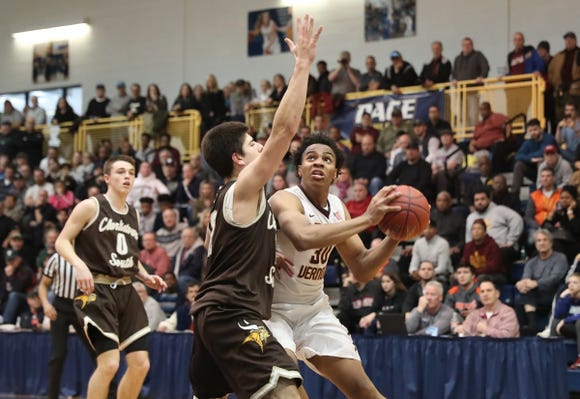 Mount Vernon's Troy Hupstead (30) works under the basket against Clarkstown South's Clarkstown South's Luke Palligudis (12) during the boys basketball Class AA section final at Pace University in Pleasantville on Saturday, March 2, 2019.