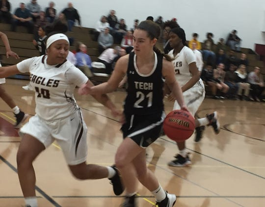 Sussex Tech's Nicolette Phillips (21) moves the ball upcourt against Hodgson's Treasure Baskerville on Friday night during the second round of the DIAA Girls Basketball Tournament at Hodgson.