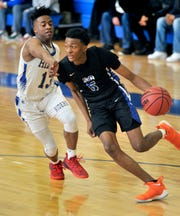 Nah'Shon Hyland of St. Georges (5) drives past Caesar Rodney defender Zayquan Eaton in first quarter of a DIAA state tournament quarerfinal game Saturday.