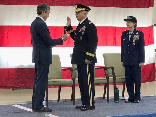 Delaware Gov. John Carney swears in Brig. Gen. Michael Berry as the state's new adjutant general. Berry replaced the retiring Maj. Gen. Carol Timmons (right) on Saturday in a change of command ceremony in New Castle.