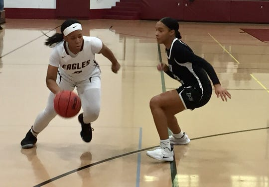 Hodgson's Kayla Braxton-Young (left) drives against Sussex Tech's Arnaisa Taylor on Friday night during the second round of the DIAA Girls Basketball Tournament at Hodgson.