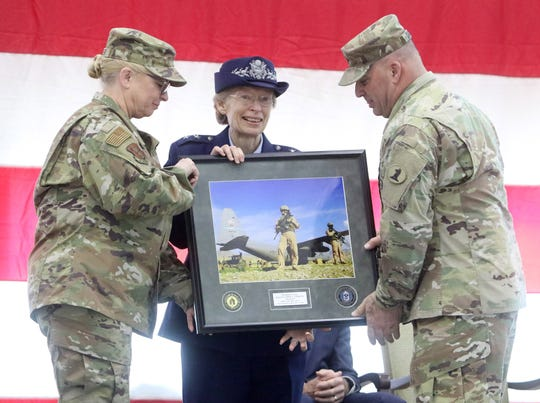 Maj. Gen. Carol Timmons is presented with a framed portrait of her during one of her earlier missions by representatives of the enlisted men and women of the Delaware National Guard during the change of command ceremony Saturday.