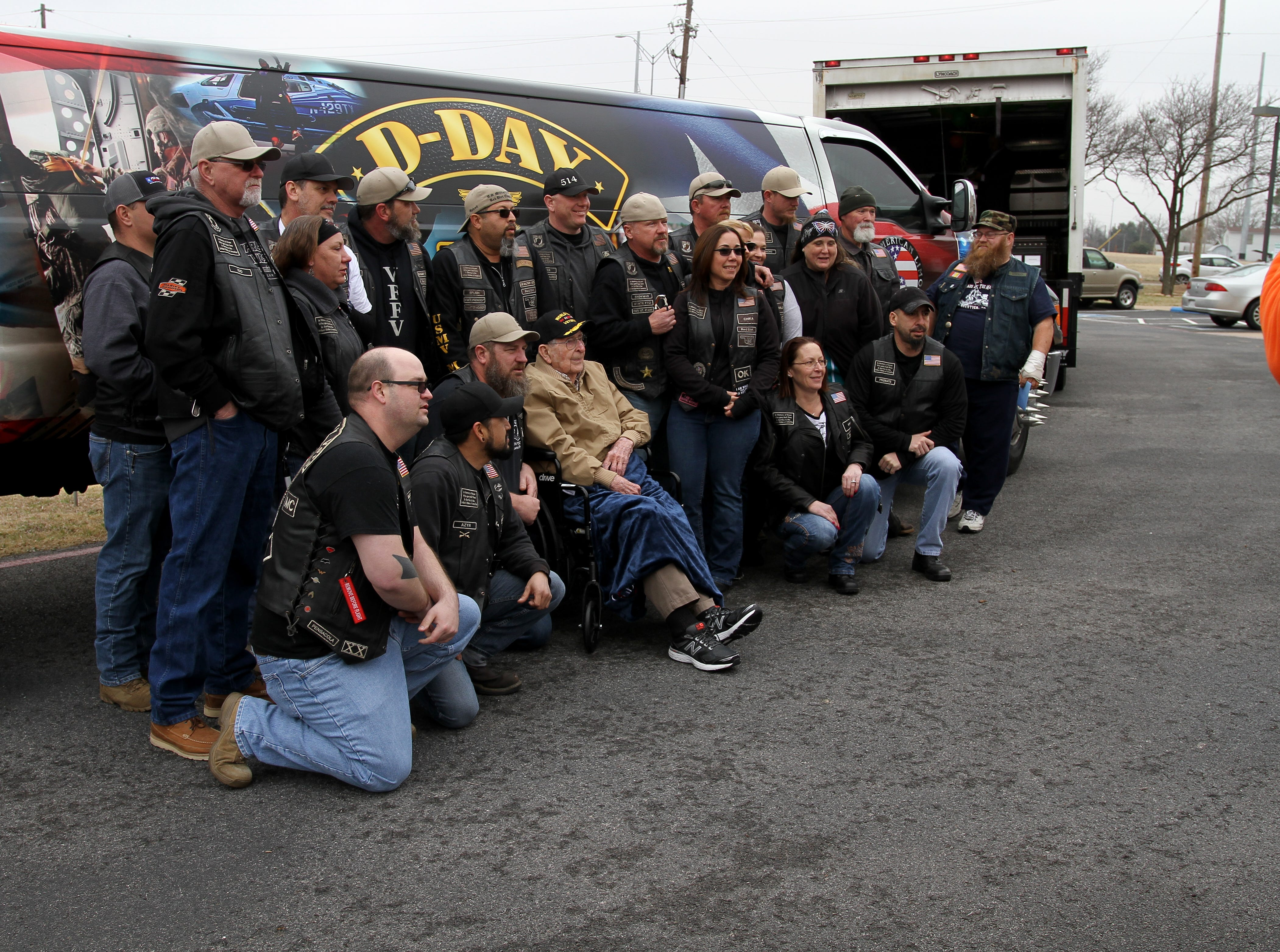 WWII veteran Joe Cuba has his photo taken with the U.S. Military Vets Motorcycle Club at his 100th birthday party Saturday, March 2, 2019, at Brookdale Midwestern.