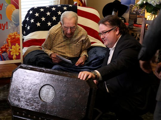 Bob Vincent presents WWII veteran Joe Cuba a life chest at Cuba's 100th birthday party Saturday, March 2, 2019, at Brookdale Midwestern.
