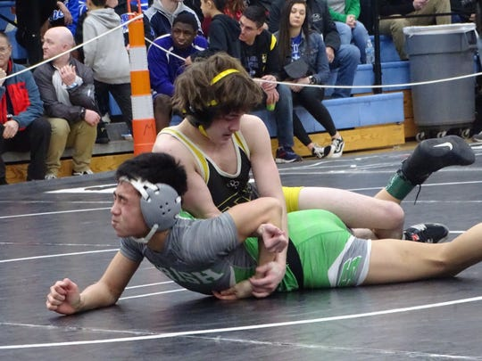Tri-Valley's Sky Wisecarver wrestles Dublin Scioto's Dylan Le in a 106-pound semifinal at Saturday's Division I district meet. Wisecarver lost that match but still qualified for the state meet.