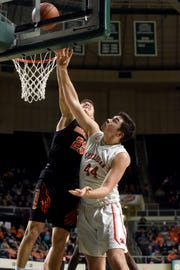 Sheridan's Grant Heileman goes up for a shot in the lane against Waverly's Easton Wolf during the second half of the Generals' 65-45 win in a Division II district semifinal at Ohio University.