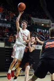 Costa Coconis, of Sheridan, shoots in the lane against Waverly on Friday night in a Division II district semifinal at Ohio University.