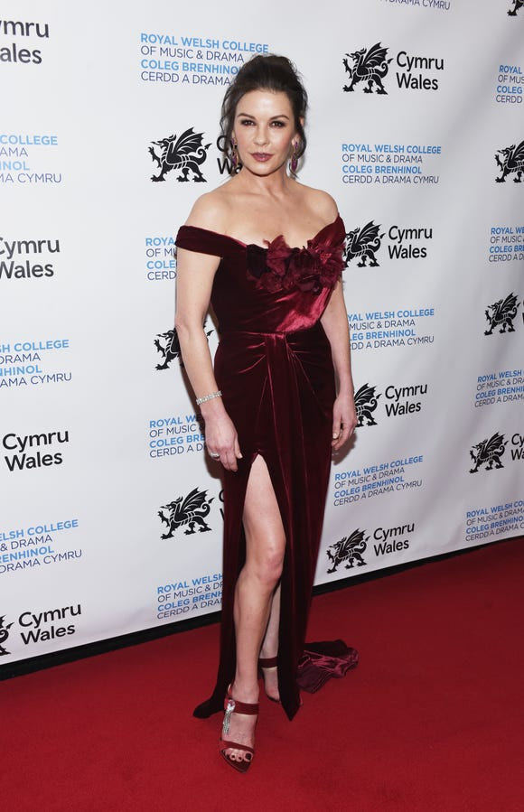 Catherine Zeta-Jones stunned in an off-the-shoulder velvet dress with a thigh-high slit at The Royal Welsh College of Music & Drama 2019 Gala at The Rainbow Room on March 1, 2019 in New York City.